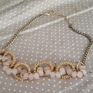 Gold necklace with gold and pink beading.